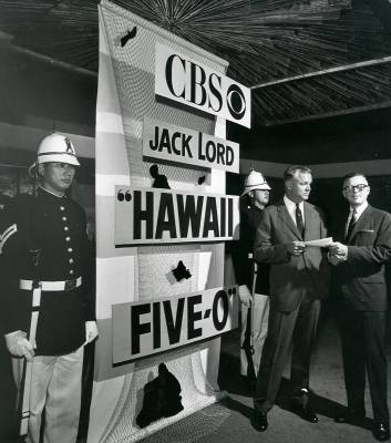 Perry Laffery and Mike Dann beside the sign. The guys in the helemts are th Royal Hawaiian Guards