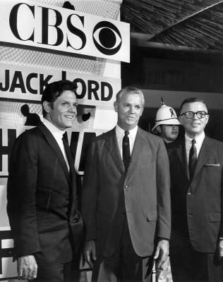 Jack Lord, Mike Dann and Perry Lafferty beside the sign